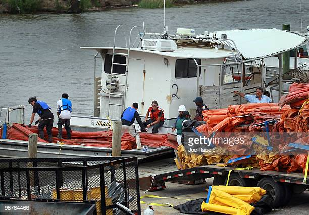 Workers load oil booms onto a boat as the effort continues to try and contain the massive oil spill in the Gulf of Mexico on May 1 2010 in St Bernard...