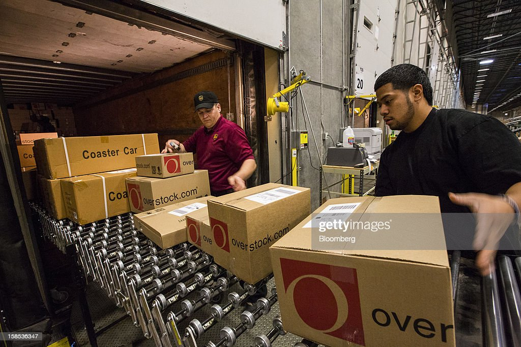 Workers load orders on to a United Parcel Service Inc. (UPS) truck at the Overstock.com Inc. distribution center in Salt Lake City, Utah, U.S., on Tuesday, Dec. 18, 2012. Online sales may grow to a record $43.4 billion in the last two months of the year, a 17 percent increase from last year, according to ComScore Inc. Photographer: Ken James/Bloomberg via Getty Images