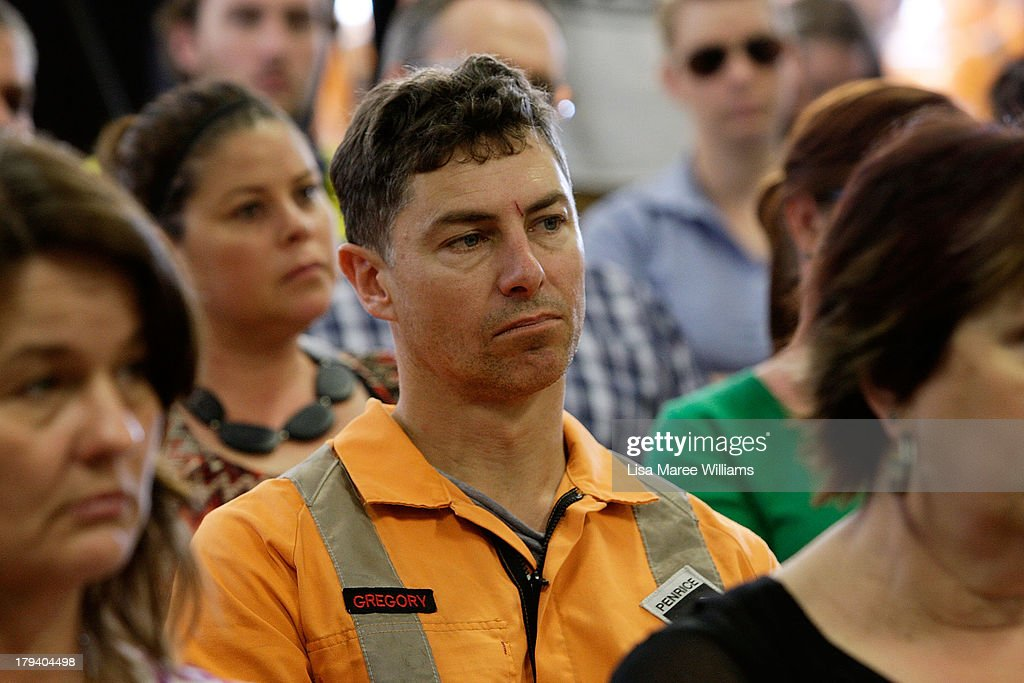 Workers look on as they wait for Australian Opposition Leader, Tony Abbott to speak on September 3, 2013 in Adelaide, Australia. In the 2010 election the Australian Labor Party recorded its highest two-party-preferred vote since 1969 in South Australia, but if nationwide polling proves accurate the Liberal-National Party coalition believe they can gain seats in the state.