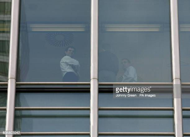 Workers look out through the windows of the Lehman Brothers headquarters at Canary Wharf in London Lehman Brothers a top US investment bank has filed...