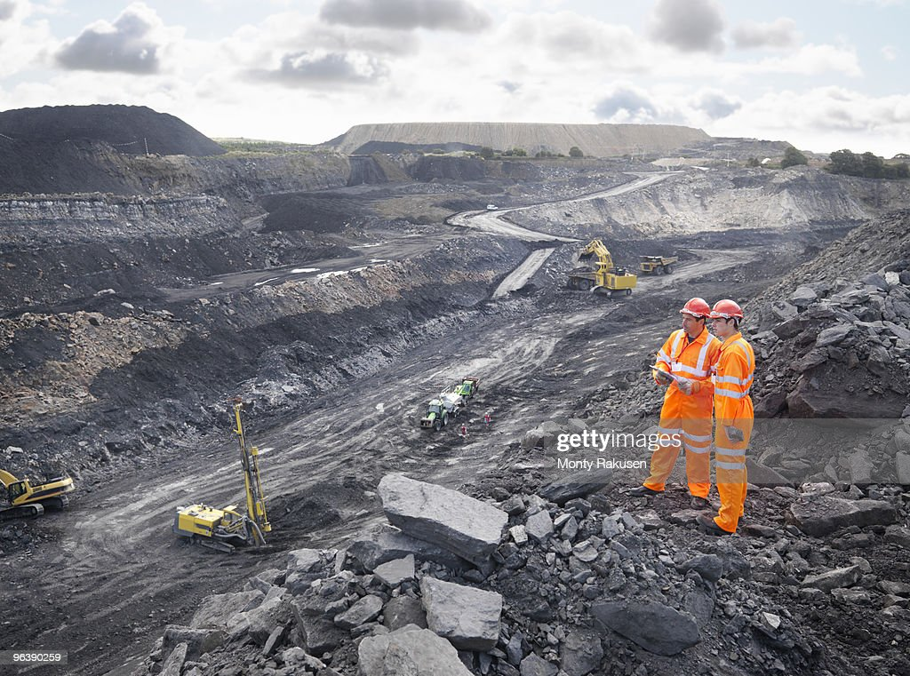 Workers Looking Over Coal Mine