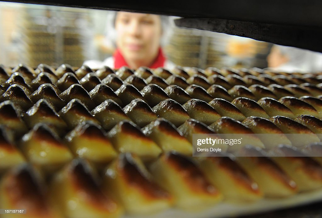 A workers looks at a tray of freshly baked almond pastry 'empenadas' at the Santo Tome Obrador de Mazapan cake bakery on November 29, 2012 in Toledo, Spain. The company, which employs 45 staff throughout the year, has hired an extra 25 workers leading up to the christmas festivities hoping comsumption picks up over the holiday period.
