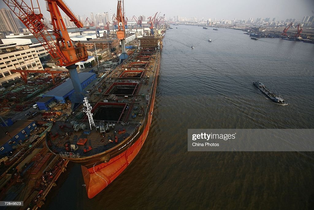 Workers maintain a vessel at a dock of the Jiangnan Shipyard on December 18, 2006 in Shanghai, China. Jiangnan Shipyard, established in 1865 during the Qing Dynasty, is one of the leading shipbuilders in China and regarded as cradle of China's national industry. The shipyard will expand its shipbuilding capacity from the current 800,000 deadweight tons (DWT) a year to 4.5 million by 2010. The Chinese mainland has been the world's third-biggest shipbuilder for the past 11 years, with a 20 per cent share of the global market last year, according to state media.