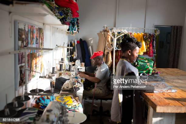 Workers make clothes in an African clothing and fabric store in Maboneng district on March 18 2016 in downtown Johannesburg South Africa A former...