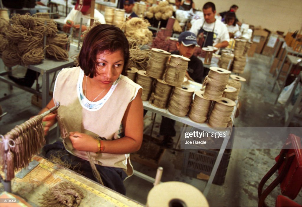 Workers make decorative tassles for curtains in a maquila in Ciudad Juarez Mexico From Matamoros Mexico to Tijuana US owned maquiladoras employ a...