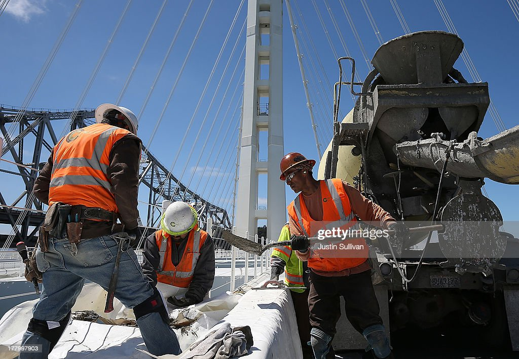 Workers make last minute reapairs on the eastern span of the new Bay Bridge on August 26, 2013 in San Francisco, California. After nearly 12 years of construction and an estimated price tag of $6.4 billion, the new eastern span of the Bay Bridge is set to open on September 3. The bridge will be the world's tallest Self-Anchored Suspension (SAS) tower once completed.