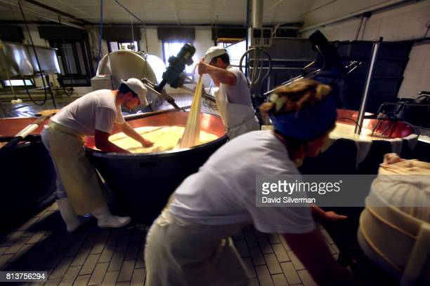 Workers make ParmigianoReggiano cheese in the traditional method at Caseificio Censi the Censi family dairy on March 25 2017 in Santa Croce a farming...