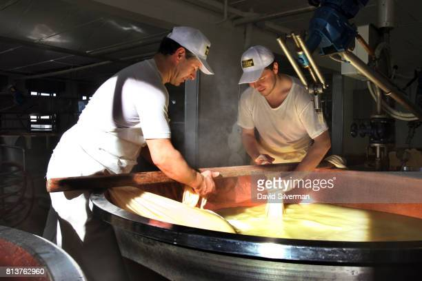 Workers make ParmigianoReggiano cheese in the traditional method at Caseificio Censi the Censi family dairy on March 26 2017 in Santa Croce a farming...