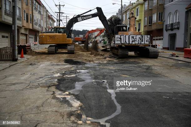 Workers make repairs to a street on July 12 2017 in San Francisco California According to a report by WalletHub roads in San Francisco Oakland and...