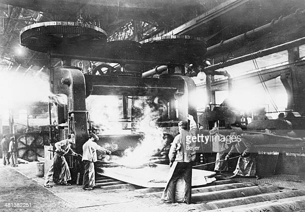 Workers making a steel plate at the Krupp factories Essen circa 1920