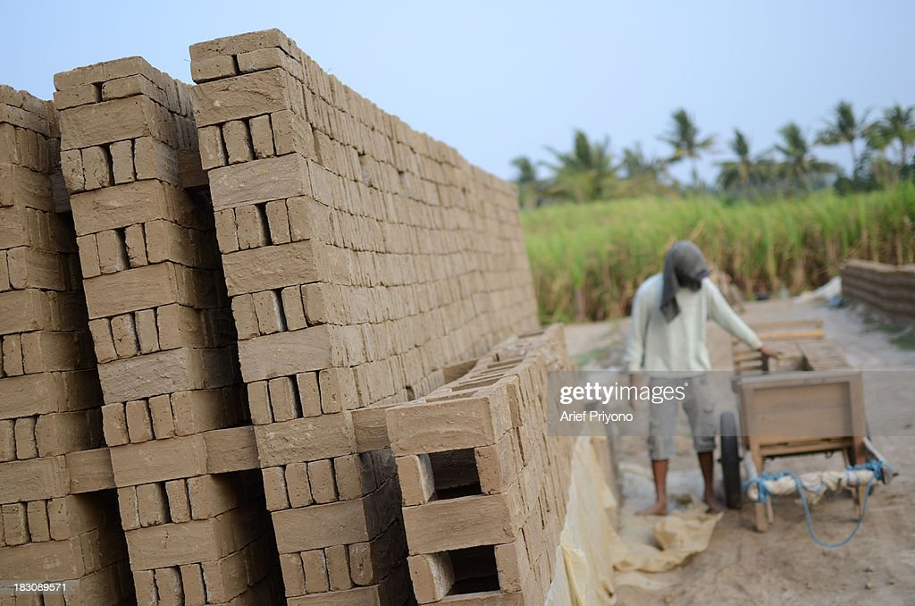 Workers making bricks in a former sugarcane field in Silir village. Many farmers in Indonesia have had to convert agricultural land because it is no longer profitable. Consequently Indonesian agricultural production has declined. Although Indonesia is an agricultural country, it still has to rely heavily on imported food staples such as rice, sugar, soybeans and corn. The Central Statistics Agency (BPS) announced that the number of farming households in Indonesia has decreased by 5.04 million families in the past 10 years. The 2003 Census of Agriculture claimed 31.17 million farm households. But in 2013 the number had fallen to 26.13 million. Indonesia has been listed as the world's largest sugar exporter. In 1930, when Indonesia was still called the Dutch East Indies, some 179 sugar factories produced over 3 million tons of sugar each year. Currently there are only 62 sugar factory in Indonesia..