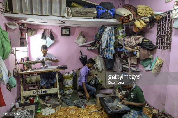 Workers manufacture wallets at a leather workshop in the Dharavi area of Mumbai India on Tuesday July 18 2017 India's new goods and services tax...