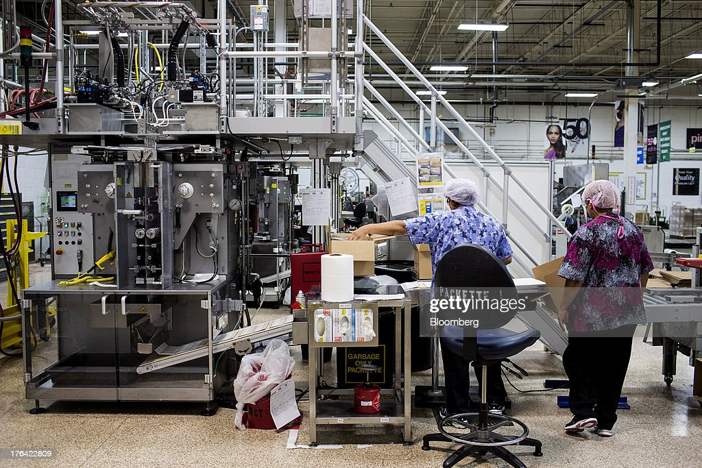 Workers monitor a machine filling sample packets at the Mary Kay Inc. manufacturing facility in Dallas, Texas, U.S., on Tuesday, Aug. 6, 2013. About 350,000 Mary Kay businesses were started globally in the past year, including 90,000 in the first quarter of 2013, according to a company press release. Photographer: T.J. Kirkpatrick/Bloomberg via Getty Images