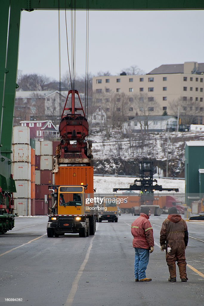 Workers monitor freight containers being loaded onto trucks at the Port Of Halifax's Fairview Cove container terminal, operated by Cerescorp Co., in Halifax, Nova Scotia, Canada, on Wednesday, Jan. 30, 2013. Statistics Canada (STCA) is scheduled to release gross domestic product data on Jan. 31. Photographer: Aaron McKenzie Fraser/Bloomberg via Getty Images