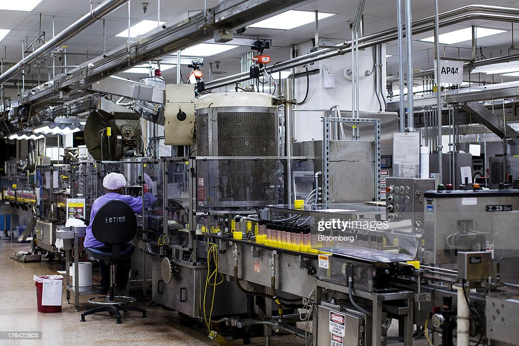 Workers monitor machines producing cosmetic products at the Mary Kay Inc. manufacturing facility in Dallas, Texas, U.S., on Tuesday, Aug. 6, 2013. About 350,000 Mary Kay businesses were started globally in the past year, including 90,000 in the first quarter of 2013, according to a company press release. Photographer: T.J. Kirkpatrick/Bloomberg via Getty Images