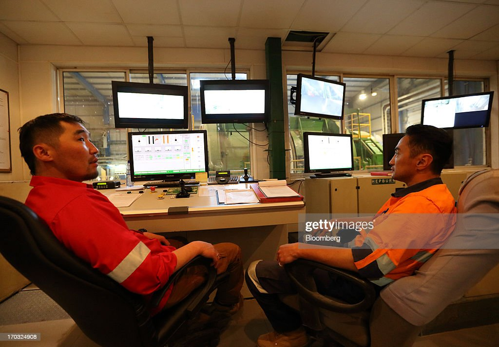 Workers monitor screens in the control room for the underground pit at the Oyu Tolgoi copper-gold mine, jointly owned by Rio Tinto Group's unit Turquoise Hill Resources Ltd. and Erdenes Oyu Tolgoi LLC, in Khanbogd, the South Gobi desert, Mongolia, on Friday, June 7, 2013. Rio Tinto, the world's second-biggest mining company, is expected to start first shipments from its $6.6 billion copper-gold mine in Mongolia this month. Photographer: Tomohiro Ohsumi/Bloomberg via Getty Images