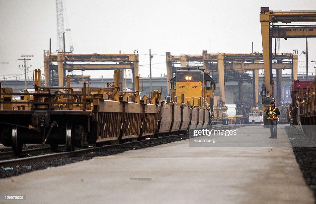 A workers monitors the coupling of well cars together which will carry intermodal containers at the Union Pacific Intermodal Terminal in Oakland, California U.S., on Wednesday, Jan. 23, 2013. Union Pacific Corp., the largest U.S. railroad by sales, posted higher fourth-quarter earnings than analysts estimated as shipments of chemicals and automobiles climbed. Photographer: Ken James/Bloomberg via Getty Images
