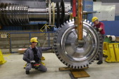 Workers move a disc of a gas turbine at the Siemens gas turbine plant on November 11 2012 in Berlin Germany Earlier in the Siemens announced plans to...