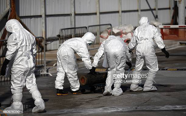 Workers move a gas bottle during a chicken cull in Hong Kong on December 31 after the deadly H7N9 virus was discovered in poultry imported from China...