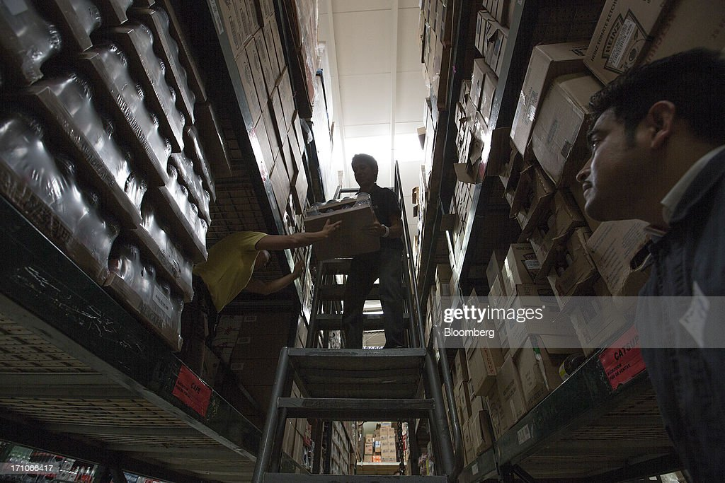 Workers move boxes in the warehouse at a Wal-Mart Stores Inc. location in Mexico City, Mexico, on Thursday, June 20, 2013. Mexican retail sales rose 2.5 percent in April from the same month last year, the country's statistics agency, known as Inegi, reported on its website. Photographer: Susana Gonzalez/Bloomberg via Getty Images