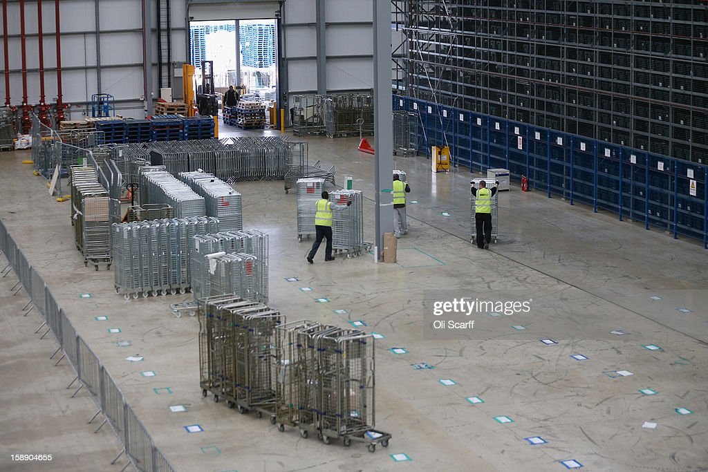 Workers move carts in the giant semi-automated distribution centre where the company's partners process the online orders for the John Lewis department store on January 3, 2013 in Milton Keynes, England. John Lewis has published their sales report for the five weeks prior December 29, 2012 which showed online sales had increased by 44.3 per cent over the same period in 2011. Purchases from their website Johnlewis.com now account for one quarter of all John Lewis business.