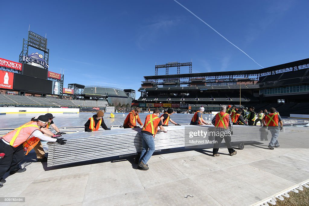 Workers move ice pans as part of the rink build out for the 2016 Coors Light Stadium Series at Coors Field on February 12, 2016 in Denver, Colorado. The game is scheduled to be played on Feb 27.