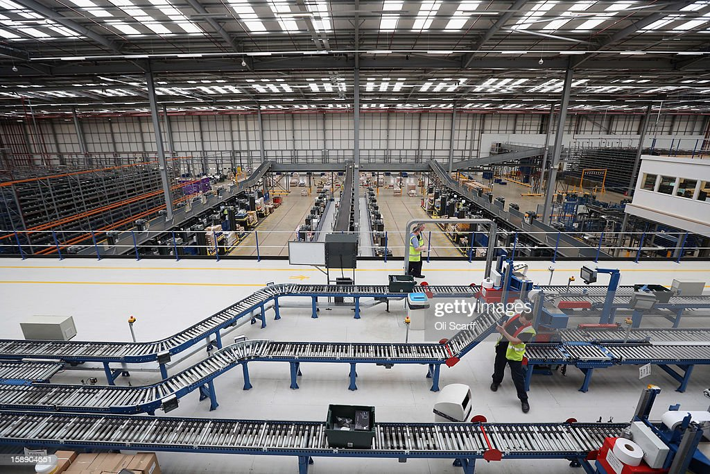 Workers move items for an assembly line in the giant semi-automated distribution centre where the company's partners process the online orders for the John Lewis department store on January 3, 2013 in Milton Keynes, England. John Lewis has published their sales report for the five weeks prior December 29, 2012 which showed online sales had increased by 44.3 per cent over the same period in 2011. Purchases from their website Johnlewis.com now account for one quarter of all John Lewis business.
