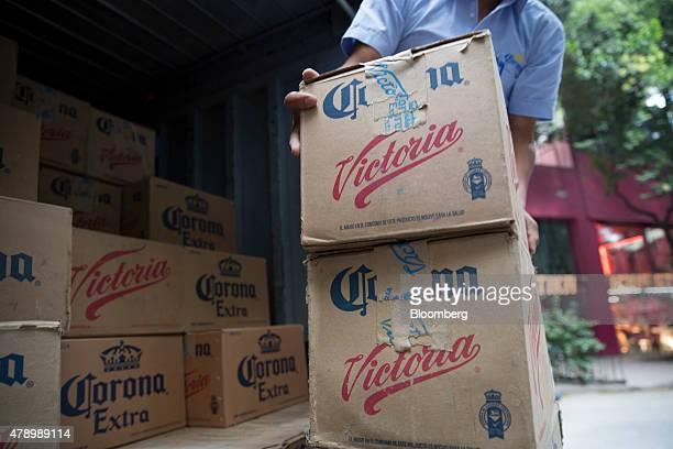 A workers moves cases of Constellation Brands Inc Corona and Victoria beer during a delivery in the Zona Rosa neighborhood in Mexico City Mexico on...