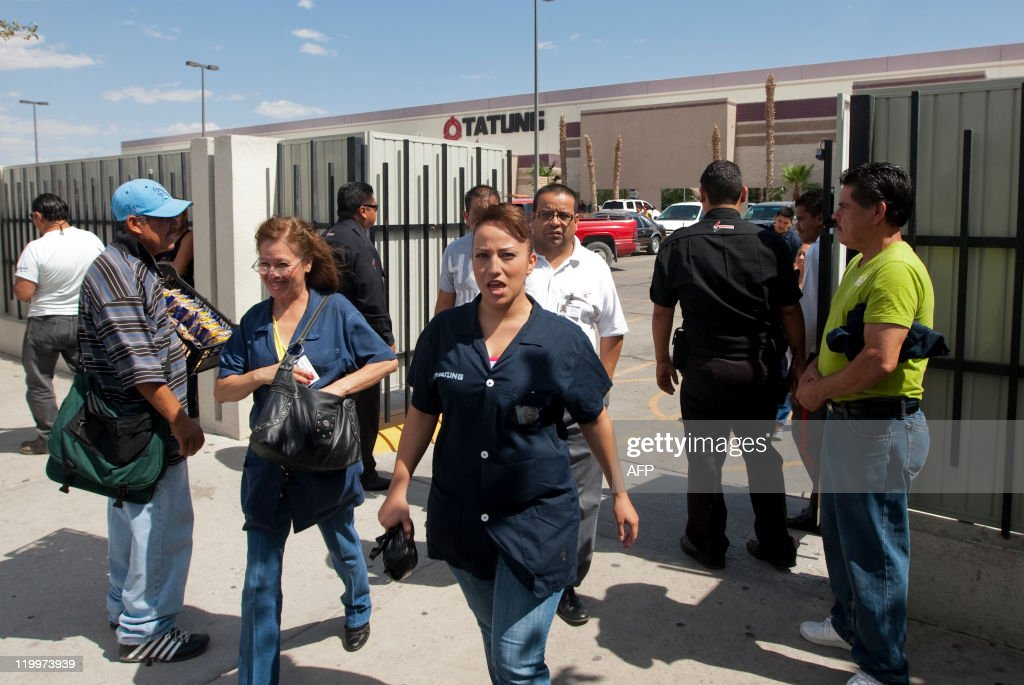 Workers of a crossborder plant leave the factory after a work day in Ciudad Juarez Mexico on June 13 2011 While local businesses have been devastated...