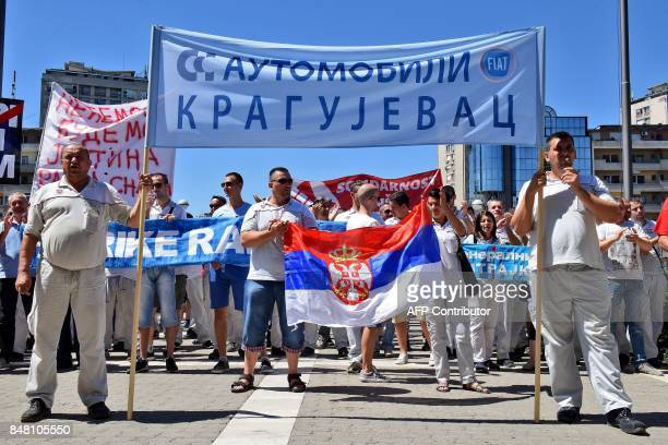 Workers of a Fiat carmaking plant take part in a strike in Kragujevac a city in central Serbia on July 14 2017 Qualified cheap and little protected...