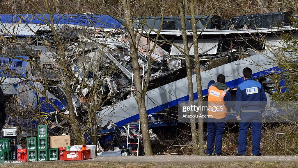 Workers of a railway company called 'Meridian' are seen on duty at the two trains' collision site after two commuter trains collied on a route, close to Bad Aibling, approximately 60 kilometers (40 miles) southeast of Munich, Germany on February 09, 2016. At least 8 killed and several others injured after the collision, reported.