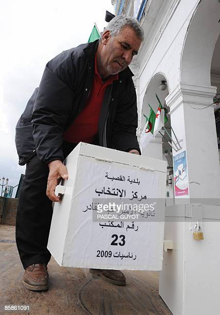 Workers of Algiers city hall load ballot boxes onto a truck on April 8 2009 in Algiers on the eve of the presidential election The African Union will...