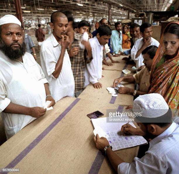 Workers of Bangladesh's stateowned Adamjee Jute Mill collect their pay slips in Narayangang 20 killometers east of Dhaka 30 June 2002 Curtain falls...