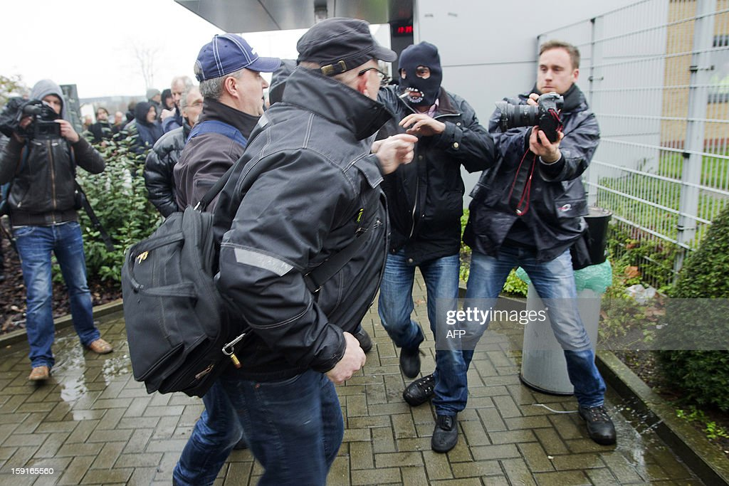 Workers of Ford Genk and its suppliers fight at the entrance of the Ford factory in Genk during a protest, as other workers started work again, at the assembly factory of Ford in Genk, on January 9, 2013. A thin majority of workers voted to start to work again at the factory earlier in the week but some workers decided to block all access to the plant in protest. Ford Europe announced at the end of last October that the Ford Genk production plant will be closed by the end of 2014. AFP / BELGA / KRISTOF