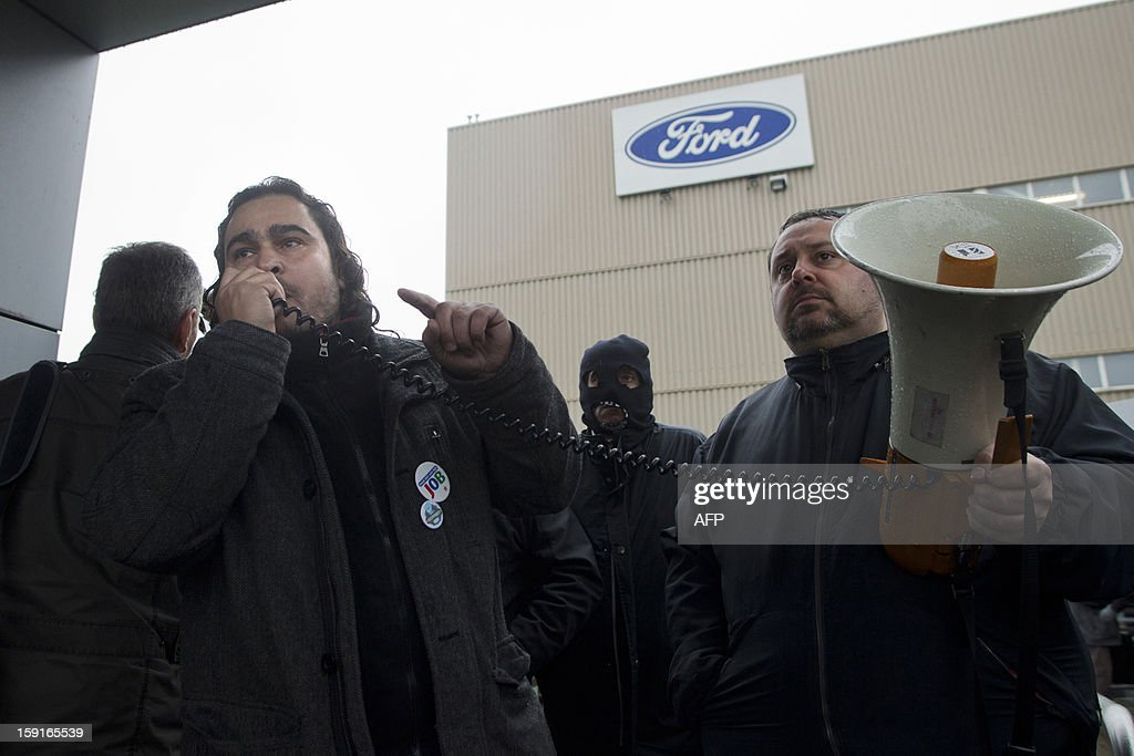 Workers of Ford Genk and its suppliers protest at the entrance of the Ford factory in Genk as other workers started work again, at the assembly factory of Ford in Genk, on January 9, 2013. A thin majority of workers voted to start to work again at the factory earlier in the week but some workers decided to block all access to the plant in protest. Ford Europe announced at the end of last October that the Ford Genk production plant will be closed by the end of 2014. AFP / BELGA / KRISTOF