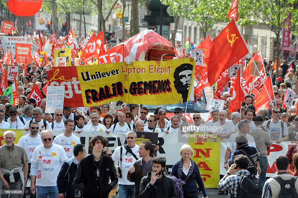 Workers of Fralib factory (Unilever group) in Gemenos, southeastern France, take part in a demonstration on May 5, 2013 in Paris, called by Jean-Luc Melenchon, leader of Front de Gauche (Left Front) left wing party, to protest 'against the austerity, against the finance and to ask for a Sixth Republic'. When France's president Francois Hollande swept to power on May 2012 on a wave of discontent, he could hardly have imagined that a year later he would be the most unpopular president in modern French history. AFP PHOTO / PIERRE ANDRIEU