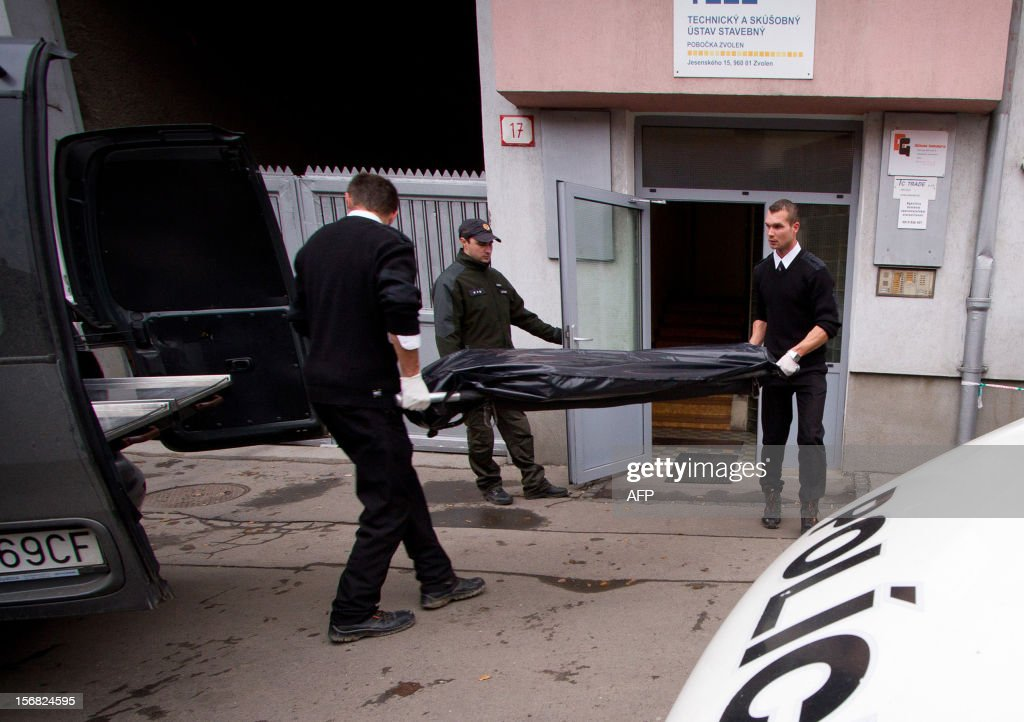 Workers of funeral company take a body of a victim on November 22, 2012 after a former employee shot dead three former colleagues at Slovak engineering firm TC Trade in the city of Zvolen, central Slovakia. A disgruntled company executive walked into his former employer's offices in Zvolen, central Slovakia, and shot dead three ex-colleagues before being arrested, police said.
