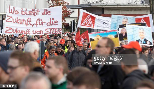 Workers of German heavy industry giant ThyssenKrupp hold up a banner reading ' What about the future of Steel' on November 23 2017 in Andernach...