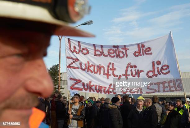 Workers of German heavy industry giant ThyssenKrupp hold up a banner reading 'Where is the future for the future of STEEL' on November 23 2017 in...