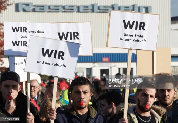 Workers of German heavy industry giant ThyssenKrupp hold up signs reading 'We are the future' on November 23 2017 in Andernach southern Germany...