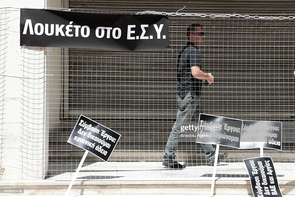 Workers of Greece State Hospital Federation cover the entrance and exit of Ministry during protest against the social security law at Ministry of Health in Athens, Greece on June 29, 2016.