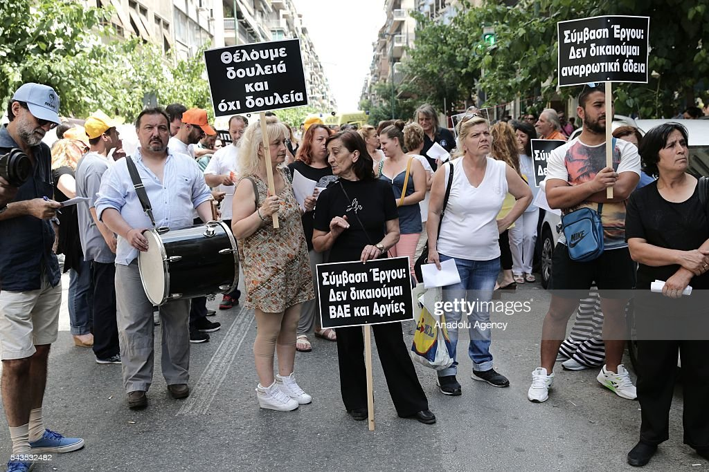 Workers of Greece State Hospital Federation hold banners during protest against the social security law at Ministry of Health in Athens, Greece on June 29, 2016.
