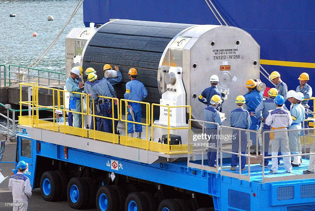 Workers of Kansai Electric Power Co (KEPCO) check a cask container of MOX fuel, a blend of plutonium and uranium, after it was unloaded from a vessel at the KEPCO's Takahama nuclear power plant in Fukui prefecture on June 27, 2013. A vessel loaded with reprocessed nuclear fuel from France arrived at a Japanese nuclear plant, the first such shipment since the Fukushima disaster as utilities lobby to restart their atomic reactors.