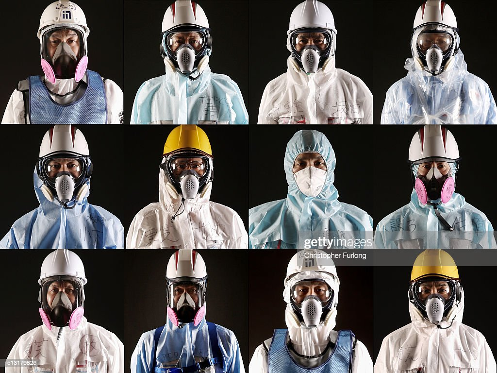Workers of TEPCO and the Kajima Corporation at the Fukushima Daiichi nuclear power plant pose for portraits on February 23 2016 in Okuma Japan March...