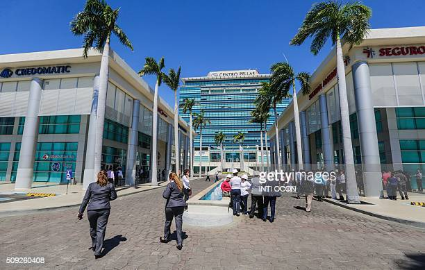 Workers of the Centro Pellas building evacuate it after a 41 degree quake in the Richter scale quake in Managua on February 9 2016 There were no...