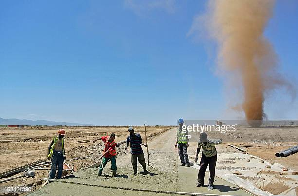 Workers of the Ethiopian Railways Corporation work at a construction site for a new Chinesebuilt railway in Dire Dawa north eastern Ethiopia on...