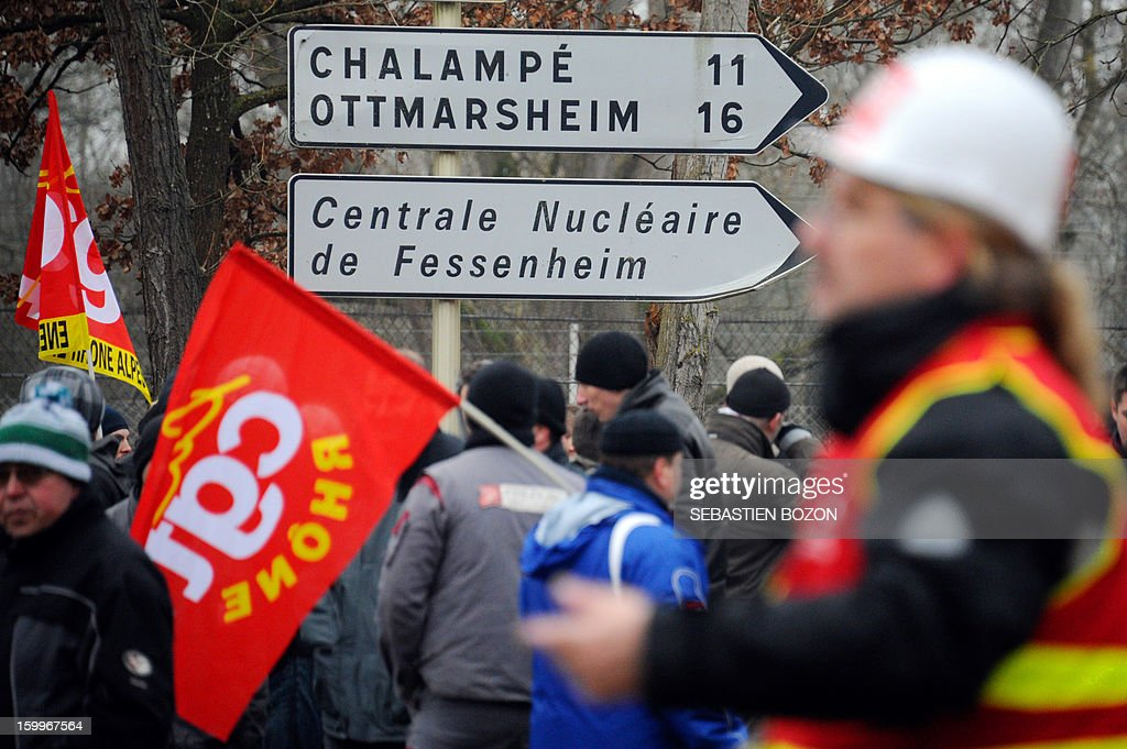 Workers of the Fessenheim nuclear plant demonstrate on January 24, 2013 in Fessenheim, eastern France to protest against French government's decision to close the oldiest French nuclear power plant.