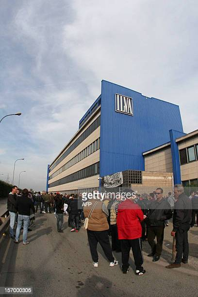 Workers of the ILVA steel plant stand in front of the factory during a protest on November 27 2012 in Taranto Hundreds of striking Italian steel...