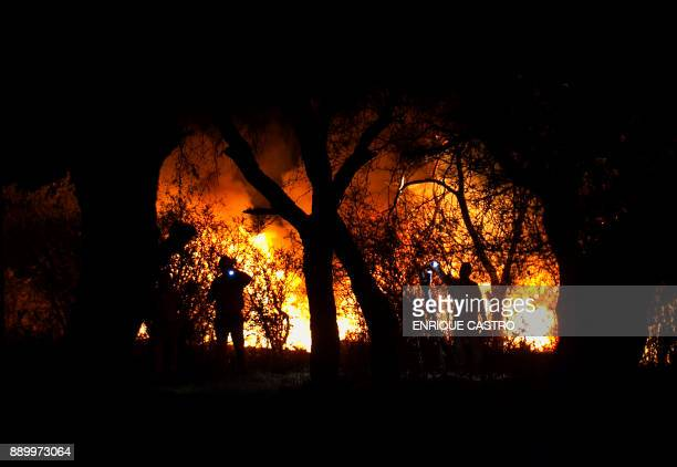 Workers of the Mexican stateowned oil company Pemex and local firefighters work to control a fire believed to have started in a pipeline due to...