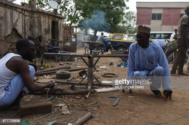 Workers of the Polio Victims Trust Association tries to weld a panel at the workshop in Kano northwest Nigeria on April 21 2017 The World Health...